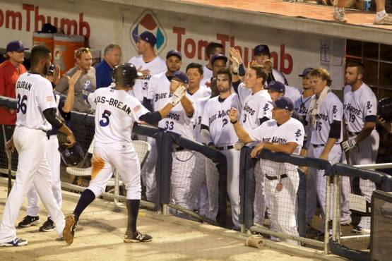 Seth Mejias-Brean celebrates with teammates after a home run. (Barrett McClean/Pensacola Blue Wahoos)